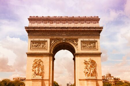 Paris, France - famous Triumphal Arch (Arc de Triomphe) located at the end of Champs-Elysees street. Filtered style colors. photo
