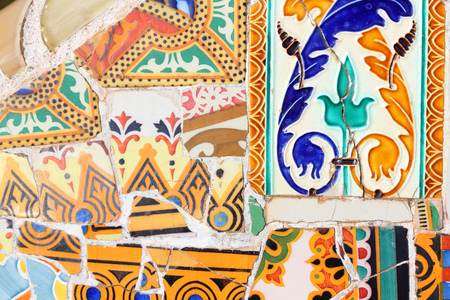 trencadi: BARCELONA, SPAIN - NOVEMBER 6, 2012: Mosaics in Park Guell in Barcelona, Spain. The landmark was built in 1900-14 and is part of the UNESCO World Heritage Site Works of Antoni Gaudi.