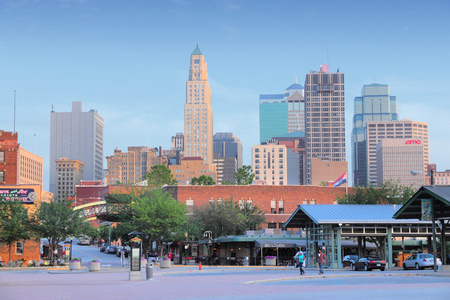 downtown: KANSAS CITY, USA - JUNE 25, 2013: People walk in downtown Kansas City, Missouri. Kansas City is the 30th largest metropolitan area in the USA with population of 2,393,623. Editorial