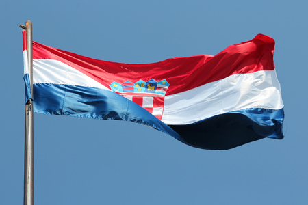 windy: Flag of Croatia on a windy day. National symbol. Stock Photo