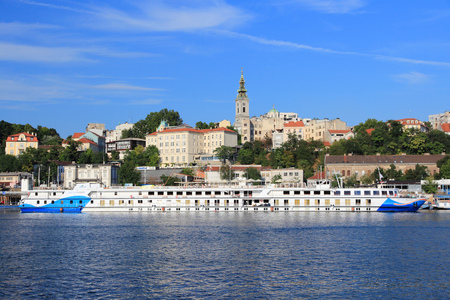 employing: BELGRADE, SERBIA - AUGUST 15, 2012: Dertour Mozart cruise ship sails in Belgrade. Dertour is part of Rewe Group, German cooperative founded in 1927, currently employing 329,000 people. Editorial
