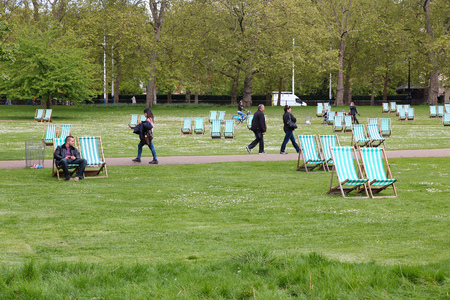 st jamess: LONDON, UK - MAY 16, 2012: People walk in St. Jamess Park in London. With more than 14 million international arrivals in 2009, London is the most visited city in the world (Euromonitor).