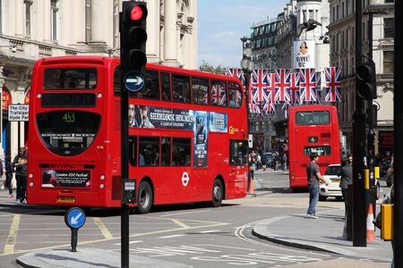 enviro: LONDON, UK - MAY 13, 2012: People ride London Bus in London. As of 2012, LB serves 19,000 bus stops with a fleet of 8000 buses. On a weekday 6 million rides are served.