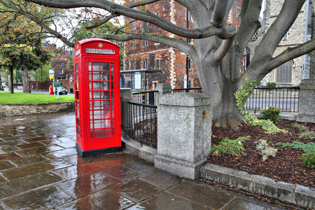 phonebooth: London, United Kingdom - red telephone box in the rain. HDR image. Stock Photo