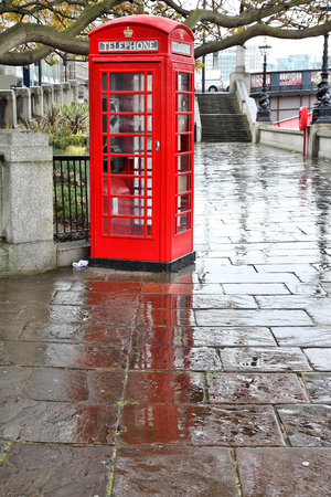 London, UK - red telephone box in the rain. HDR image. Editorial