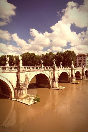 tevere: Rome, Italy. View of famous Sant Angelo Bridge. River Tevere. Cross processed color tone - retro image filtered style.