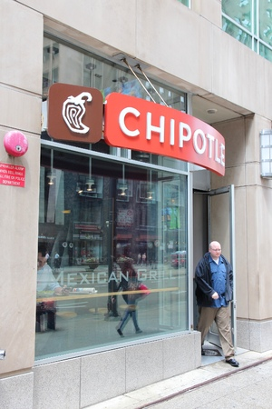 exits: CHICAGO, USA - JUNE 26, 2013: Person exits Chipotle restaurant in Chicago. As of 2013, Chipotle Mexican Grill had 1,600 locations and 45,200 employees. Editorial