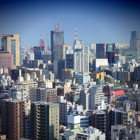 Tokyo, Japan - aerial view of Chiyoda district. Modern city skyline. Square composition. photo