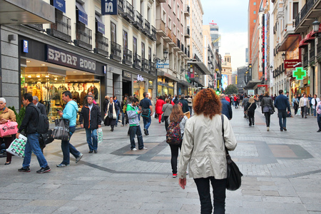 street: MADRID, SPAIN - OCTOBER 24, 2012: People shop downtown in Madrid. Madrid is a popular tourism destinations with 3.9 million estimated annual visitors (official data).