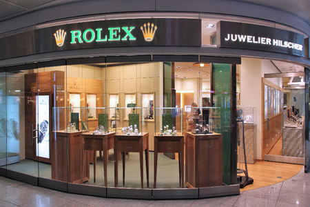 MUNICH, GERMANY - APRIL 1, 2014: Juwelier Hilscher Rolex watch store at Munich International Airport in Germany. Rolex was founded in 1909. It produces about 2,000 luxury watches daily.