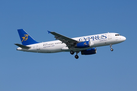 ceased: LARNACA, CYPRUS - MAY 17, 2014: Cyprus Airways Airbus A320 lands in Larnaca International Airport. Cyprus Airways ceased operations on 9 January 2015 because of financial problems. Editorial