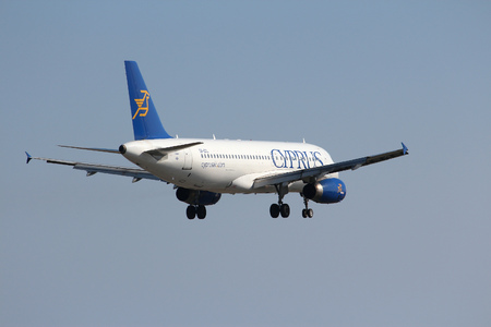 airways: LARNACA, CYPRUS - MAY 17, 2014: Cyprus Airways Airbus A320 lands in Larnaca International Airport. Cyprus Airways ceased operations on 9 January 2015 because of financial problems. Editorial