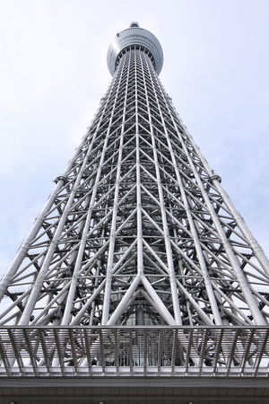seismic: TOKYO, JAPAN - APRIL 13, 2012: Skytree Tower on in Tokyo. It is the second tallest structure in the world, 634m tall. It was opened in 2012. It has concrete seismic proofing (earthquake resistant structure). Editorial