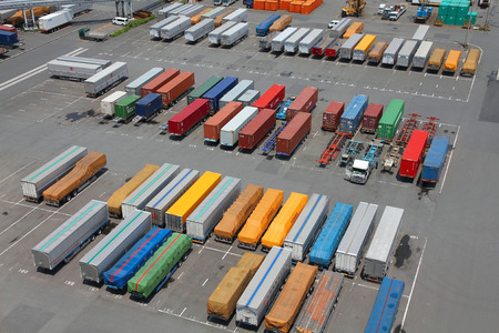 seaports: TOKYO, JAPAN - MAY 11, 2012: Containers in Port of Tokyo in Tokyo. Port of Tokyo is one of busiest seaports in the Pacific Ocean basin with 100 million tonnes of cargo handled annually.
