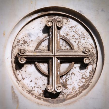 campo: Catholic cross symbol on a grave in Campo Verano cemetery, Rome, Italy. Square composition. Stock Photo