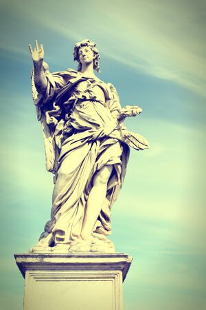 cross processed: Angel in Rome, Italy. One of the angels at famous Ponte Sant Angelo bridge. Baroque sculpture by Girolamo Lucenti. Cross processed color style - retro image filtered tone. Stock Photo