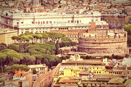 cross processed: Rome, Italy. Aerial view of famous Castel Sant Angelo and Justice Palace courthouse in background. Cross processed color style - retro image filtered tone.