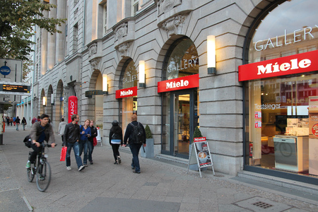 domestic appliances: BERLIN, GERMANY - AUGUST 26, 2014: People walk by Miele store in Unter den Linden, Berlin. Miele is a manufacturer of high-end German domestic appliances and was founded in 1899.