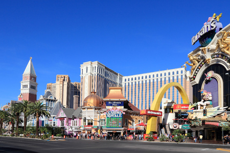royale: LAS VEGAS, USA - APRIL 14, 2014: People visit the famous Strip in Las Vegas. 15 of 25 largest hotels in the world are located at the strip with more than 60 thousand rooms.