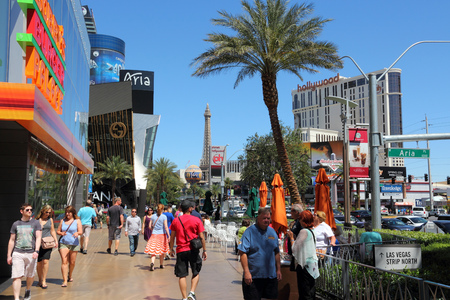north hollywood: LAS VEGAS, USA - APRIL 14, 2014: People visit the famous Strip in Las Vegas. 15 of 25 largest hotels in the world are located at the strip with more than 60 thousand rooms.