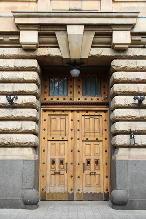 Budapest, Hungary - old residential architecture. Wooden door.
