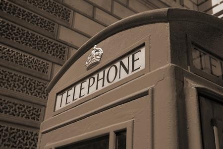 phonebooth: London, United Kingdom - red telephone box close-up. Sepia tone - filtered retro style monochrome photo. Stock Photo