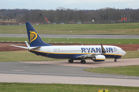 turbofan: BIRMINGHAM, UK - APRIL 24, 2013: Pilots taxi Ryanair Boeing 737 at Birmingham Airport, UK. Ryanair carried 81.4 million passengers in 2013. Editorial