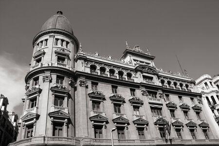gran via: Gran Via in Madrid, Spain. Black and white tone - retro monochrome color style. Stock Photo