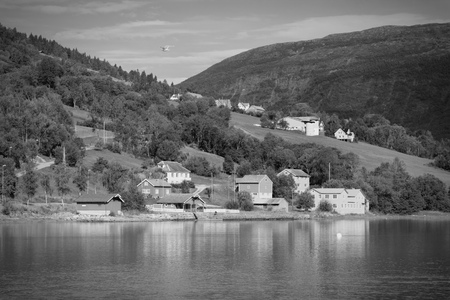 olden: Norway, Sogn of Fjordane county. Rural architecture next to Nordfjord in Olden. Black and white tone - retro monochrome color style.