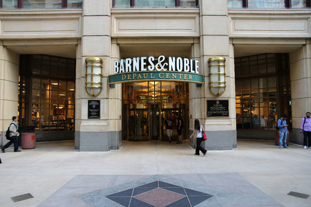 bn: CHICAGO, USA - JUNE 27, 2013: People walk by Barnes and Noble in DePaul Center in Chicago. BN bookstore business dates back to 1917. The company employs 30,000 people.