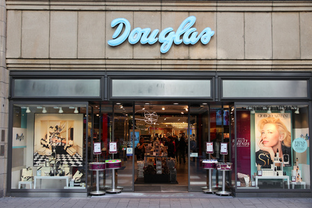 HAMBURG, GERMANY - AUGUST 28, 2014: People visit Douglas perfumery in Spitallerstrasse, Hamburg. Douglas Holding was founded in 1949 and has 2,100 stores (2014).