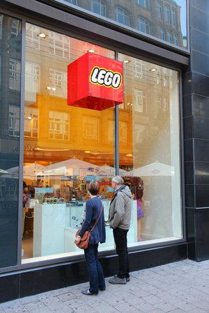 billion: HAMBURG, GERMANY - AUGUST 28, 2014: People visit Lego Store in Spitallerstrasse, Hamburg. Lego Group had 4.7 billion USD revenue in 2013 (with 1.5 billion USD income).