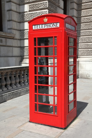 London, United Kingdom - red telephone booth typical for England. photo