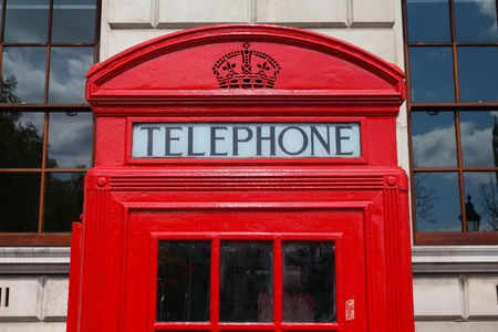 phonebooth: London, United Kingdom - red telephone booth typical for England. Stock Photo