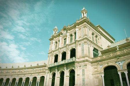 cross processed: Landmark architecture at Plaza de Espana, Sevilla, Spain. Cross processed color tone - retro image filtered style.