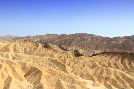 sediments: Mojave Desert in California, United States. Scenic view of Zabriskie Point in Death Valley National Park (Inyo County). Erosional landscape of sediments in Amargosa Range mountains.