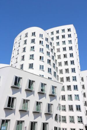 frank: DUSSELDORF, GERMANY - JULY 8, 2013: Neuer Zollhof building in Dusseldorf, Germany. The building was designed by famous Frank Gehry and completed in 1998.