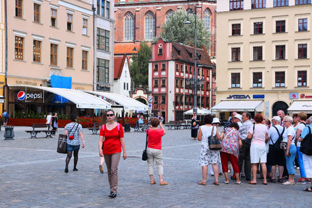 rynek: WROCLAW, POLAND - JULY 6, 2014: People visit Rynek (Market Square) in Wroclaw. Wroclaw is the 4th largest city in Poland with 632,067 people (2013). Editorial