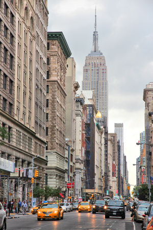 NEW YORK, USA - JULY 3, 2013: People visit 5th Avenue, Midtown Manhattan in New York. Almost 19 million people live in New York City metropolitan area. 報道画像