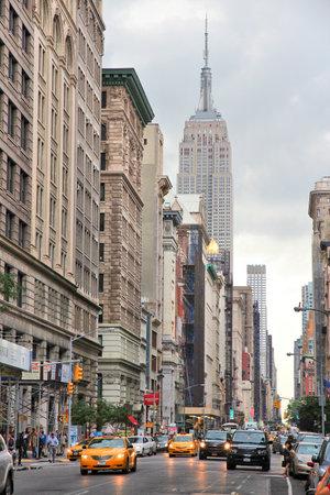 NEW YORK, USA - JULY 3, 2013: People visit 5th Avenue, Midtown Manhattan in New York. Almost 19 million people live in New York City metropolitan area. Redactioneel