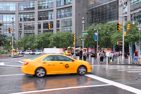 warner: NEW YORK, USA - JULY 3, 2013: Taxi drives at Columbus Circle in New York. Columbus Circle with famous Time Warner Center skyscrapers completed in 2003 is one of New York landmarks.