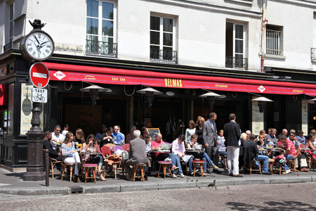 brasserie: PARIS, FRANCE - JULY 20, 2011: People visit Cafe Delmas in Paris, France. Paris is the most visited city in the world with 15.6 million international arrivals in 2011. Editorial