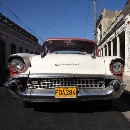 CIENFUEGOS, CUBA - FEBRUARY 3, 2011: Classic American Chevrolet car parked in the street in Cienfuegos, Cuba. Cuba has one of the lowest car-per-capita rates (38 per 1000 people in 2008).