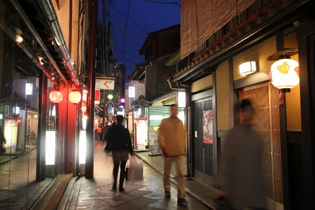KYOTO, JAPAN - APRIL 16, 2012: People visit Pontocho street in Kyoto, Japan. According to TripAdvisor, best restaurants in Kyoto are located in Pontocho.