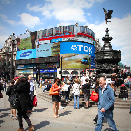 tdk: LONDON, UK - MAY 13, 2012: People visit Piccadilly Circus in London. With more than 14 million international arrivals in 2009, London is the most visited city in the world (Euromonitor).