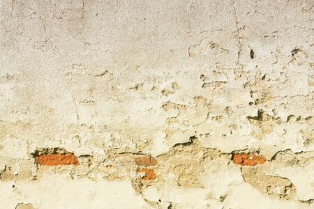 urban decay: Old wall background texture. Urban decay, peeling plaster. Filtered style toned color. Stock Photo