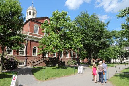 ivy league: CAMBRIDGE, USA - JUNE 9, 2013: People visit Harvard University campus in Cambridge, MA. Harvard was established in 1636. Its annual endowment is 36.4 billion USD. Editorial