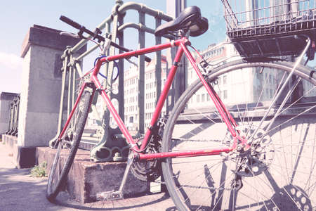 cross processed: Red bicycle parked in the city (Vienna, Austria) - red bike. Vintage color style - cross processed filtered colors tone.