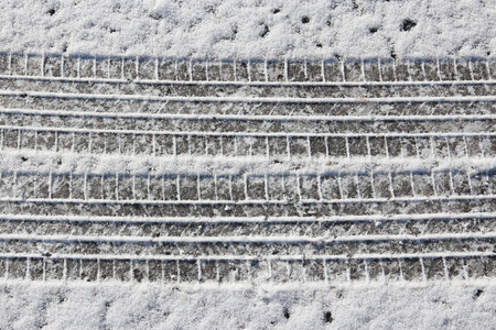 road surface: Snow tyre tracks - snowy winter road surface background.