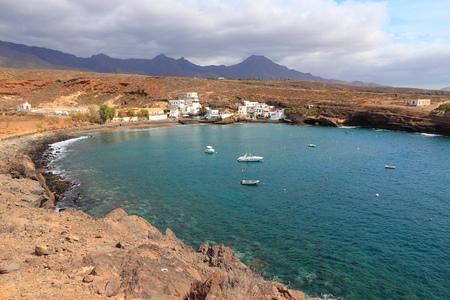 adeje: Tenerife, Canary Islands, Spain - town of El Puertito. Black sand beach of Costa Adeje coast.